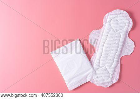 Sanitary Pad, Sanitary Napkin On Pink Background. Menstruation, Feminine Hygiene, Top View.