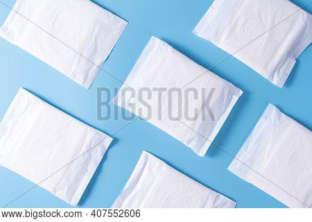 Pattern Of Sanitary Pad, Sanitary Napkin On Blue Background. Menstruation, Feminine Hygiene, Top Vie