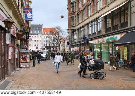 Copenhagen, Denmark - March 11, 2011: People Visit Pedestrianized Old Town Of Copenhagen, Denmark. I