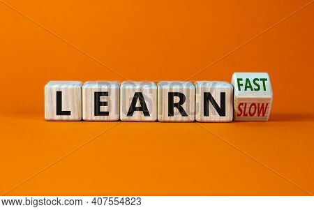 Learn Slow Or Fast Symbol. Turned Wooden Cubes And Changed Words 'learn Slow' To 'learn Fast'. Beaut