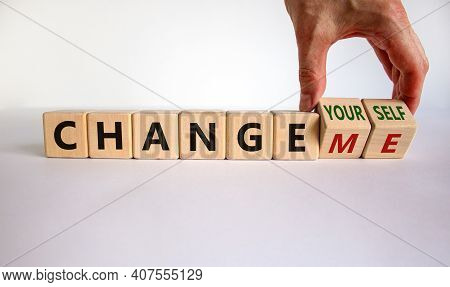 Change Yourself Or Me Symbol. Businessman Turns Wooden Cubes And Changes Words 'change Me' To 'chang
