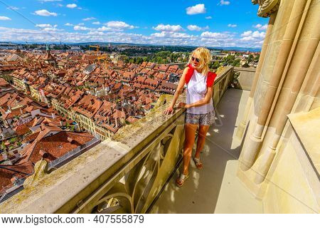 Woman Tourist Looking Bern Old Town, Capital Of Switzerland, From Panoramic Terrace Of Bell Tower Ca