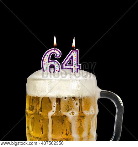 Number 64 Candle In Beer Mug For Birthday Celebration Isolated On Black