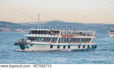 Turkey, Istanbul-december, 2020: Tourist Boat Sails On Background Of City On Coast. Action. Tourist