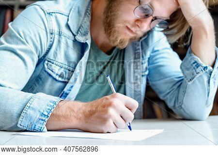 Closeup Young Concentrated Man Student Writer Hold Head Think Hard Writing Graduate Pass Take Exam H