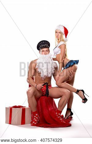 Couple In Christmas Costumes Playing Erotic Game