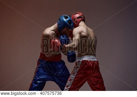 Wrestling Of Fighting Athletic Males Boxers In Studio, Martial Arts, Mixed Fight Workout