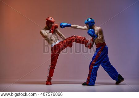 Sparring Of Two Fighting Guys In Boxing Gloves During Battle In Red Blue Light, Martial Arts, Mixed