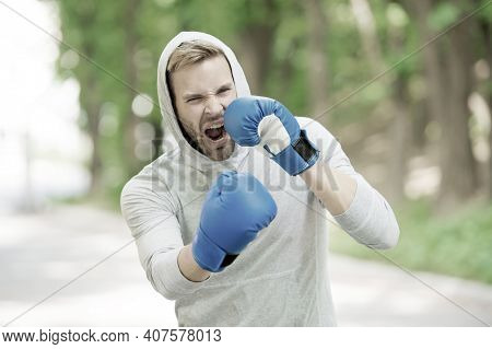 Boxing Training Endurance. Man Athlete Concentrated Face With Sport Gloves Practicing Boxing Nature
