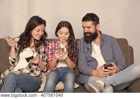 Family Online Games For Coronavirus Quarantine. Happy Child And Parent Play Online Game. Smartphone