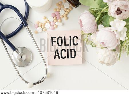 Folic Acid. Medicine Concept. Pink Paper Sticker With Inscription Folic Acid And Stethoscope, Medici