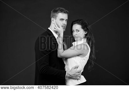 Young Couple Is Hugging Each Other. Attractive Girl With Handsome Man In Passionate Pose. Impassione