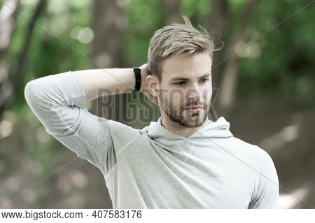 Man Confident In His Antiperspirant. Guy Checks Dry Armpit Satisfied With Clean Clothes. Sportsman A