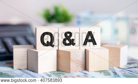 Concept Word Q And A On Wooden Blocks On Beautiful Background From Green Flower. The Word Q And A On
