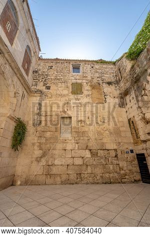 Ancient Stone Wall In Atrium Near Golden Gate Of Diocletian Palace In Split Old Town In Croatia