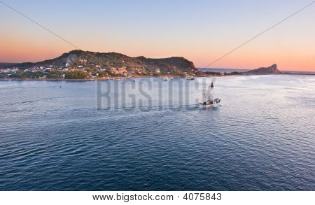 Fishing Boat In Mazatlan Heading Out To Sea
