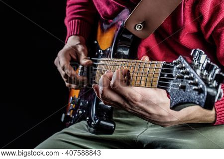 Musical Instrument. Electric Guitar. Repetition Of Rock Music Band. Music Festival. Man Playing Guit