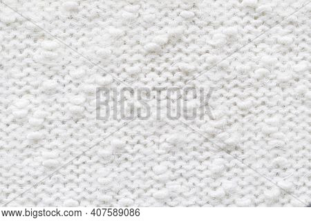 Knitted Loops Background. Knitted Texture. White Knitted Fabric Texture. White Knitting Wool Texture