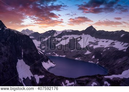 Striking Aerial Landscape View Of Silver Lake Surrounded By Rugged Mountain Peaks. Colorful Sunset S