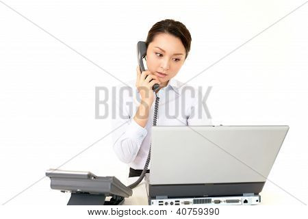 Young office worker working with computer