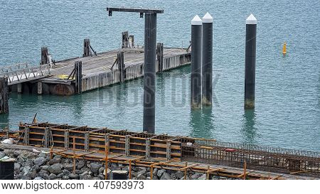 Airlie Beach, Queensland, Australia - February 2021: Industrial Site With Equipment Working On Harbo