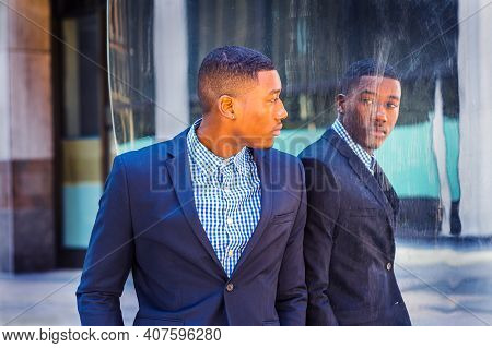 A Young Black Businessman Is Standing By A Mirror On The Street And Looking At The Reflection. Conce