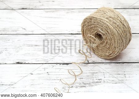 Clew Of Linen Twine On White Grunge Wooden Table