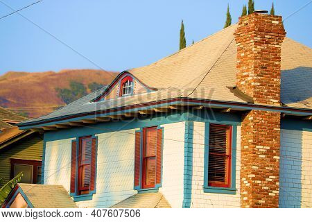 Historical Home Including An Attic And A Vintage Brick Chimney Taken In A Residential Community