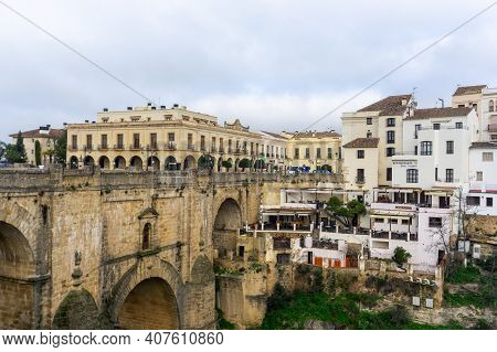 Ronda, Spain - 2 February, 2021: A View Of The Old Town Of Ronda And The Puente Nuevo Over El Tajo G