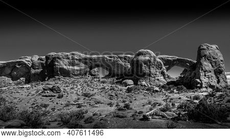 Black And White Photo Of The North And South Window Arches In The Desert Landscape Of The Windows Se