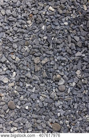 Stones Texture And Background. Rock Texture . Crushed Gravel Background. Seamless Texture Of Gravel
