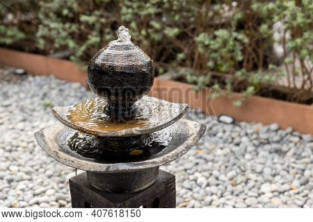 Antique Fountain At Garden. Jar Fountain In The Garden. Fountain In Garden Decoration