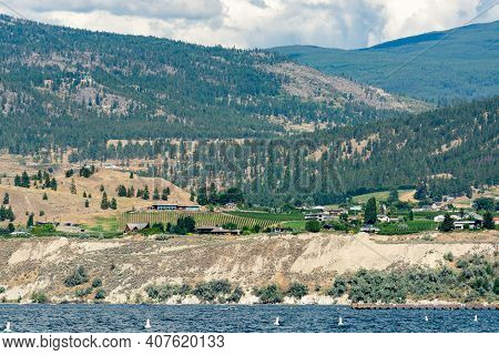 Beautiful View Over Okanagan Lake With Mountains And Clouds On Background