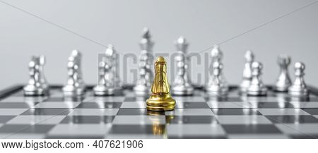 Gold Chess Knight (horse) Figure On Chessboard Against Opponent Or Enemy. Strategy, Conflict, Manage