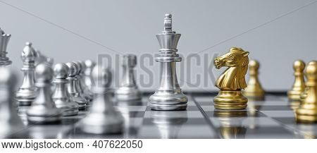 Gold And Silver Chess Figure On Chessboard Against Opponent Or Enemy. Strategy, Conflict, Management