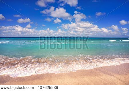 Golden Sand Beach By The Sea With Emerald Green Sea Water And Blue Sky And White Clouds. Summer Vaca