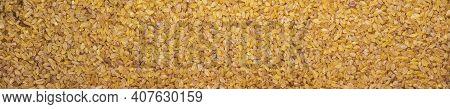 Close-up Of Bulgur Cereal Seeds. Panoramic Background Of Bulgur Cereals.