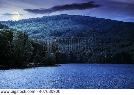 Lake Among Beech Forest In Summer At Night. Beautiful Nature Landscape In Mountains. Vihorlat Nation