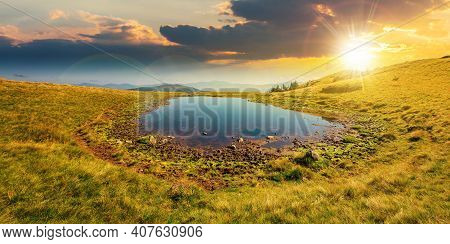 Pond On The Mountain Meadow At Sunset. Wonderful Summer Landscape In Evening Light. Grass And Trees