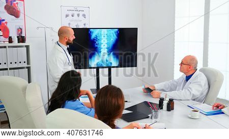 Group Of Doctors Listening Medical Expert During Medical Conference Analysing Digital Radiography, P