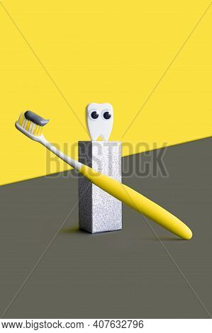 Yellow Toothbrush With Grey Toothpaste And Toy Tooth On The Dental Catwalk, Podium In Trending Color