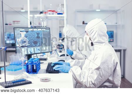 Research Scientist Typing Information Obtained Working In Modern Laboratory. Medical Engineer Using