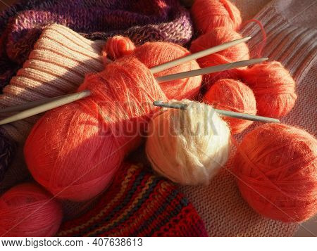 Tangles, Snarls. Balls Of Yarn And Thread, Knitted Clothes, Knitting Needles And Crochet Hooks. Pink