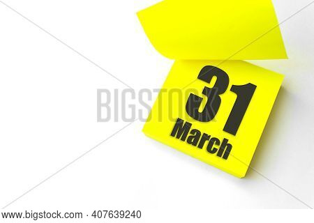March 31st . Day 31 Of Month, Calendar Date. Close-up Blank Yellow Paper Reminder Sticky Note On Whi