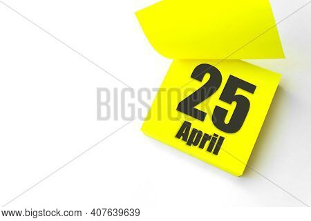 April 25th. Day 25 Of Month, Calendar Date. Close-up Blank Yellow Paper Reminder Sticky Note On Whit