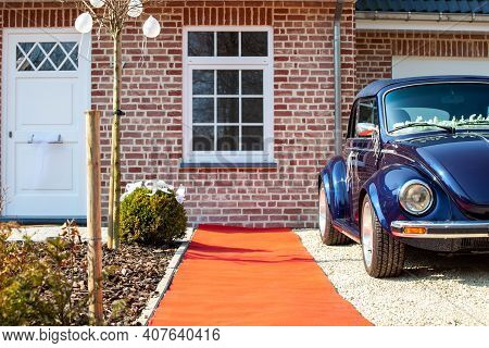 Antwerp, Belgium, March 2009: Two Blue German Classic Cars. Volkswagen Beetle In Front Of A House On
