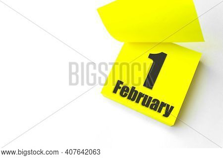 February 1st . Day 1 Of Month, Calendar Date. Close-up Blank Yellow Paper Reminder Sticky Note On Wh