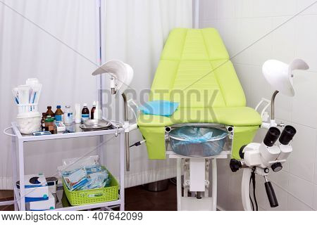 Gynecological Cabinet With Chair And Other Medical Equipment In Modern Clinic. Equipment Medicine, M
