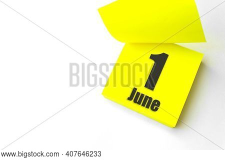 June 1st . Day 1 Of Month, Calendar Date. Close-up Blank Yellow Paper Reminder Sticky Note On White