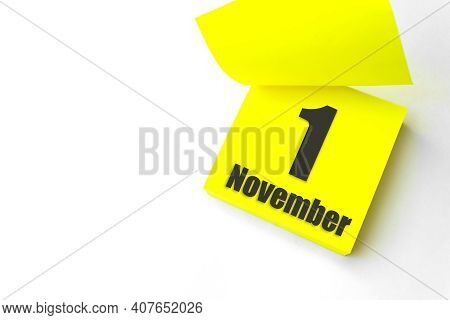 November 1st . Day 1 Of Month, Calendar Date. Close-up Blank Yellow Paper Reminder Sticky Note On Wh